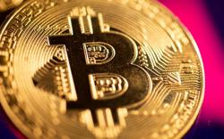 Bitcoin hits record high of US$62,575