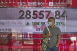 Asian shares mostly gain as China exports rise