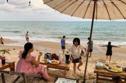 Thailand: Thousands swarm over beaches on the first day of a long national holiday despite warnings from health officials