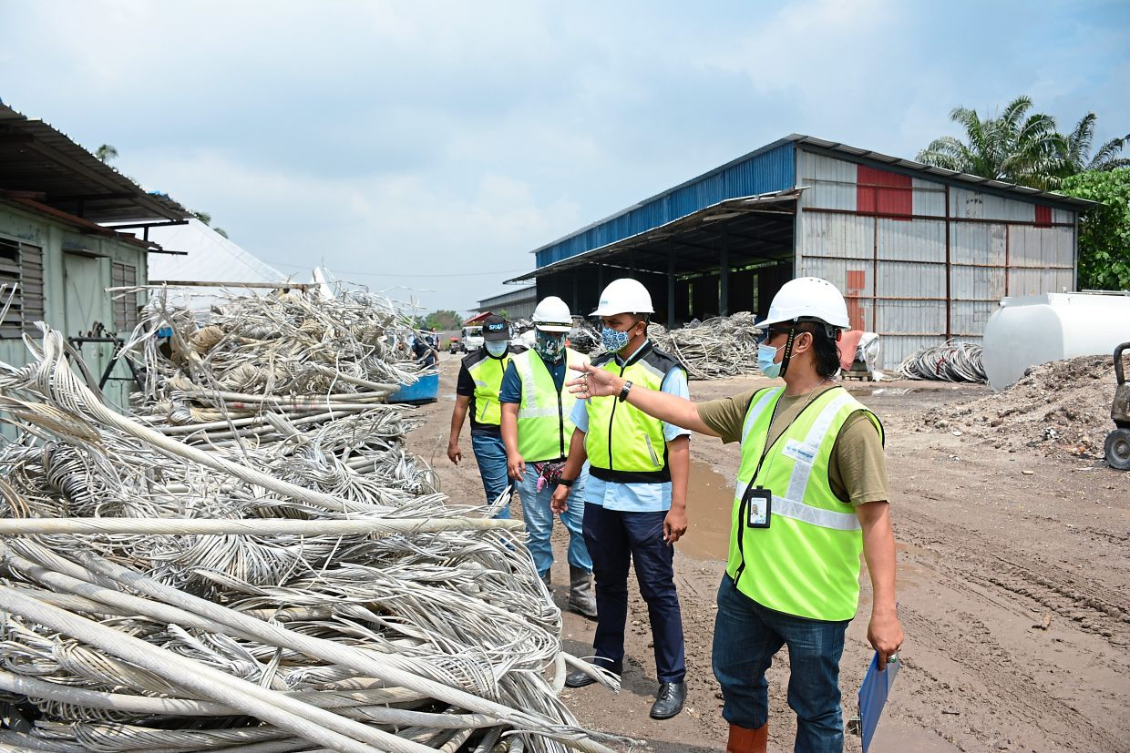 SPAN's enforcement team at the scrapyard where an illegal water connection was discovered in Telok Panglima Garang.