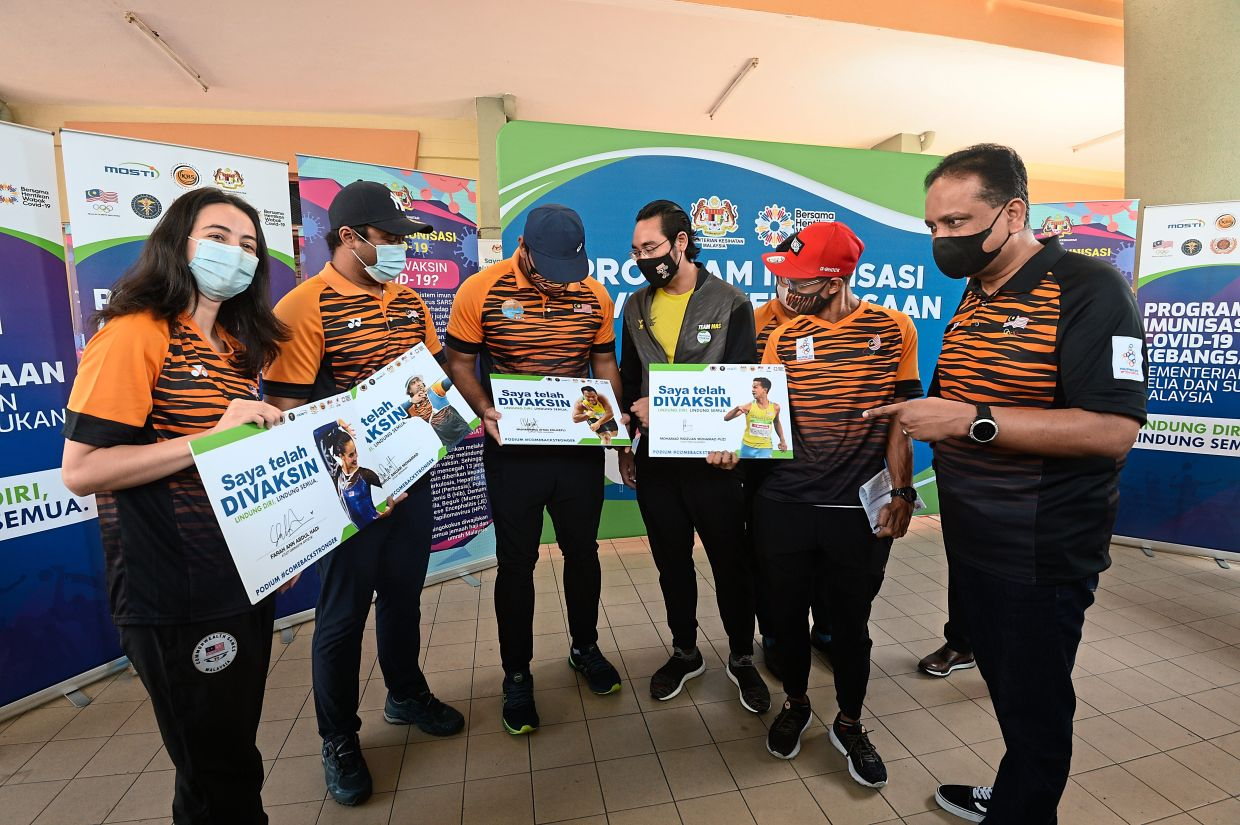Health comes first: Youth and Sports Minister Datuk Seri Reezal Merican Naina Merican (right) talking to the athletes after getting vaccinated at the National Covid-19 Immunisation Programme of the Youth and Sports Ministry yesterday. — S.S. KANESAN/The Star