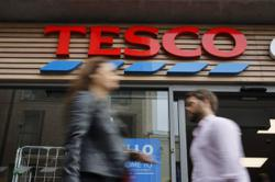 Tesco reports 2 bln pounds profit after 'exceptionally strong' sales