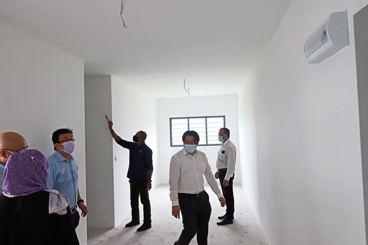 Jagdeep (right) checking out one of the Taman Prestij units.