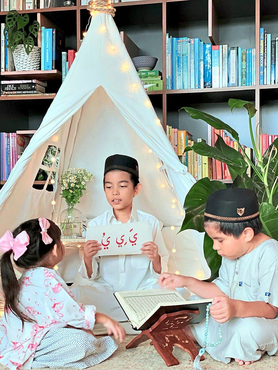 Gabriel reads the Quran as Zachary teaches Ailee to read and recite using flash cards which their mother Deelaila also used to learn from too when she was two. Photo: Deelaila Ramzi