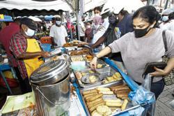 Eager to throng Ramadan bazaars