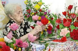Still actively making paper flowers for charity at 99
