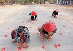 Protesters paint streets red