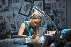 Women heal scars with tattoos