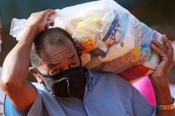 Food parcels arrive in Brazil's favelas as pandemic sparks wave of hunger