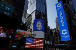 Crypto flagship Coinbase jumps 11% after stormy Nasdaq debut