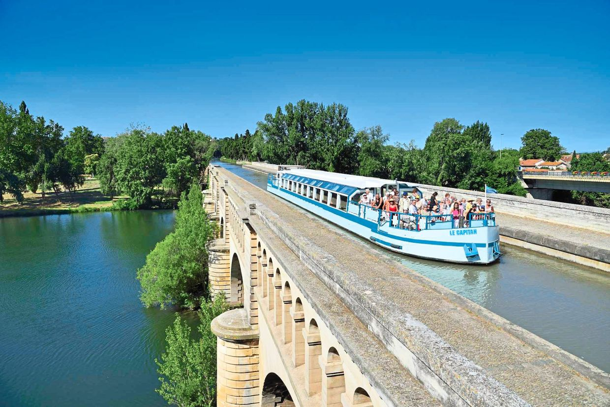 The Canal du Midi, one of France's oldest canals, is now home to an array of luxury hotel barges, offering travellers a unique vacation experience along this historic canal.