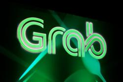 Grab considering secondary Singapore listing after US SPAC merger - sources