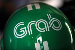 Grab mulling secondary Singapore listing after SPAC merger: sources