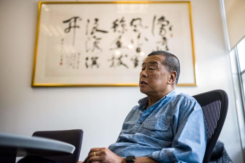 In this file photo taken on June 16, 2020, millionaire media tycoon Jimmy Lai, 72, speaks during an interview with AFP at the Next Digital offices in Hong Kong. - Lai was jailed for 12 months on April 16, 2021 over one of the city's biggest ever protests in 2019. - AFP