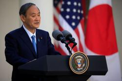 Suga says he told Biden of commitment to move forward with Olympic Games in Japan