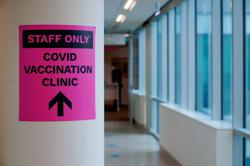 Australia to continue review of COVID vaccinations - health minister