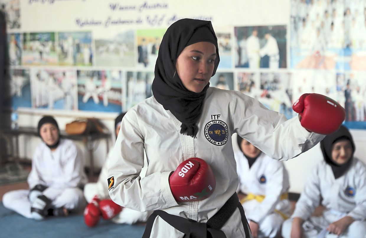 Afghan girls practice taekwondo during a training session in Kabul. Can they still do this under Taliban's rule? — AP