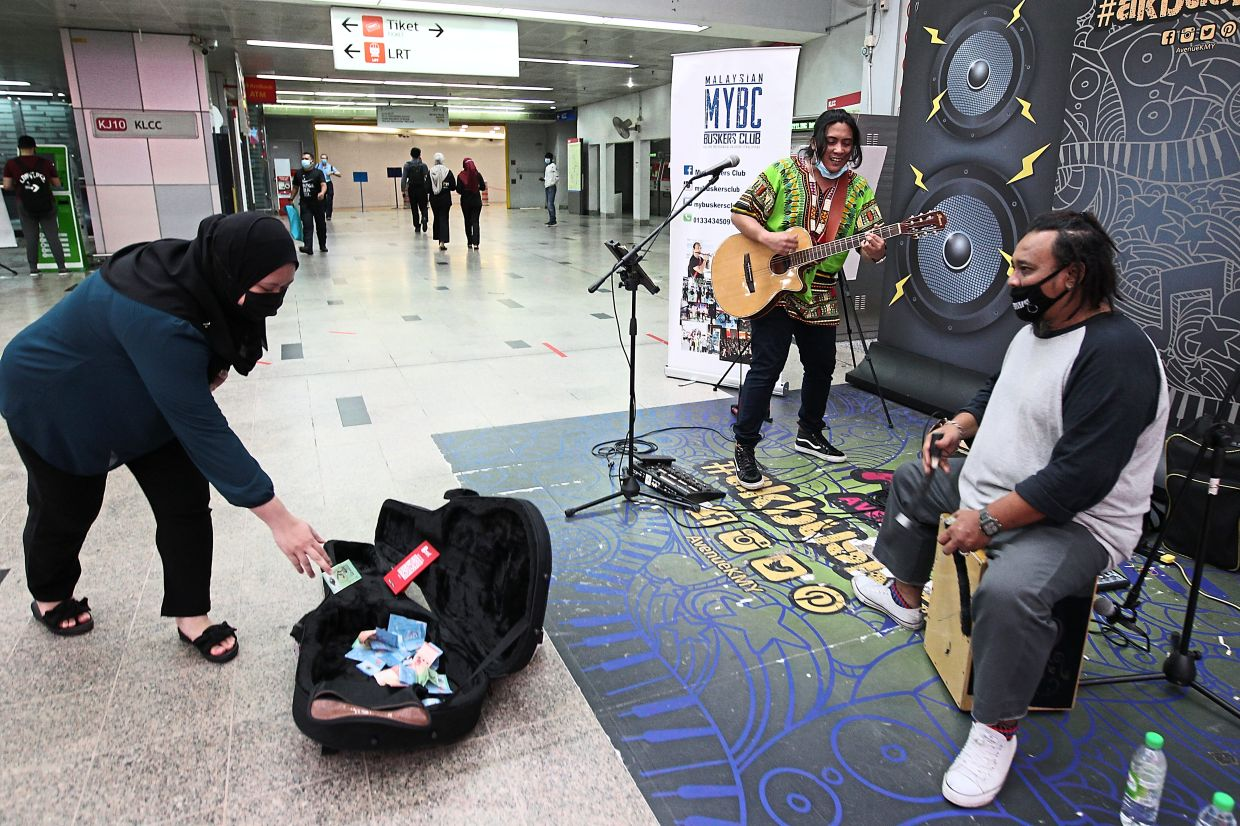 Buskers and food delivery personnel (pic, below) are part of the gig workforce.
