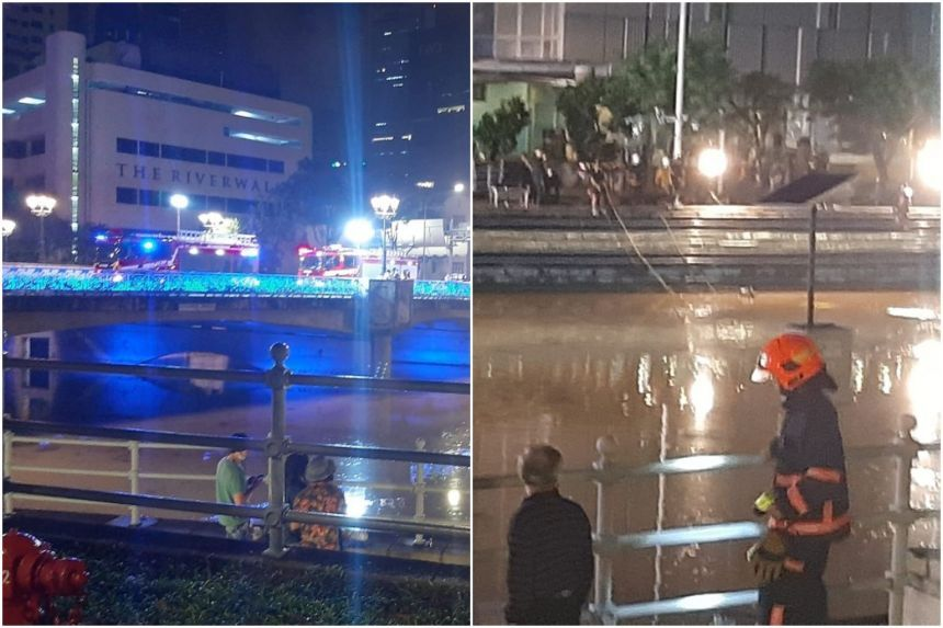 The bodies of two men were retrieved from the Singapore River on Sunday (April 18,2021). - The Straits Times/ANN