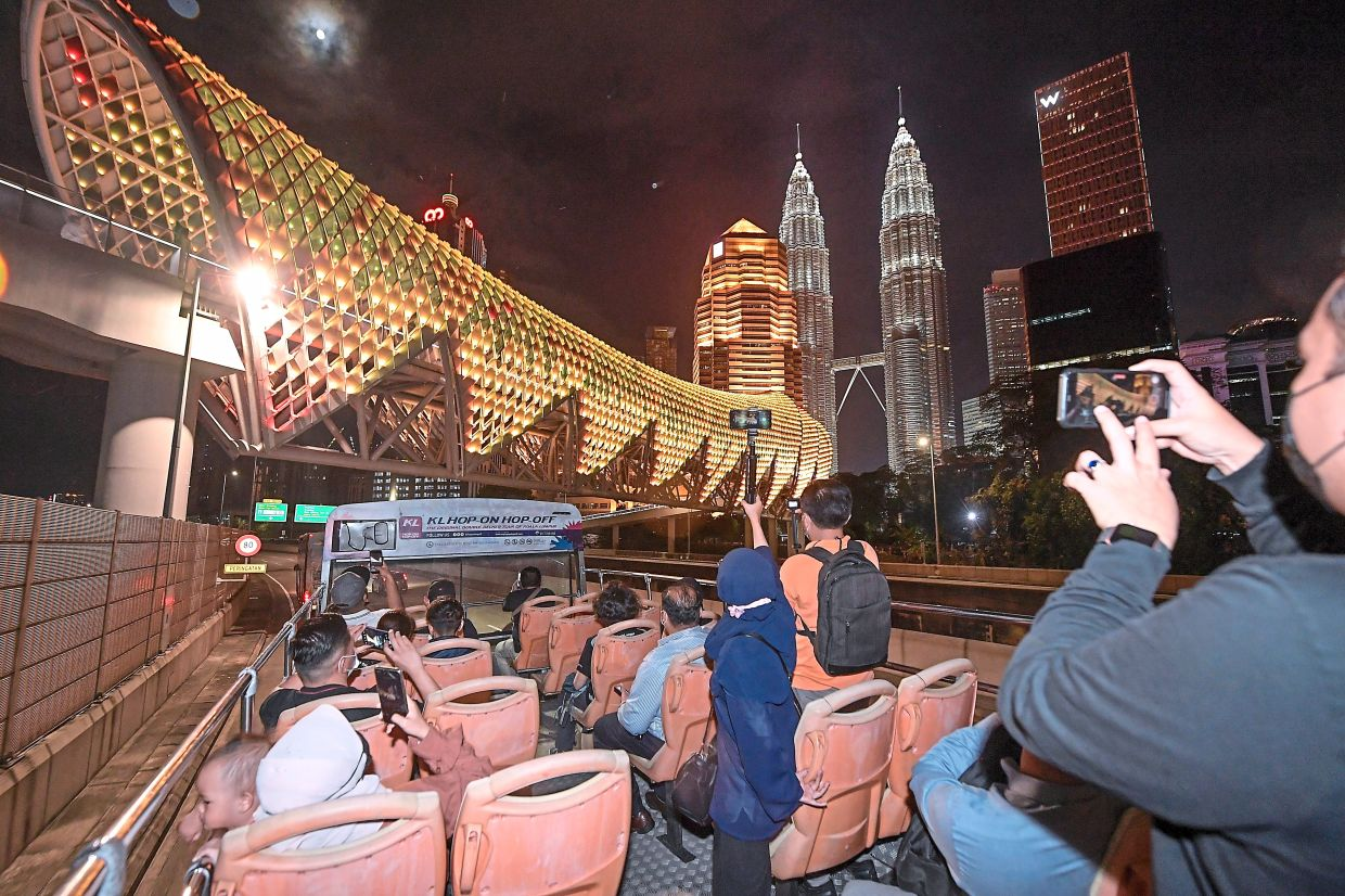 The KL Hop-On Hop-Off bus gives passengers a chance to tour the capital city at night. — Bernama