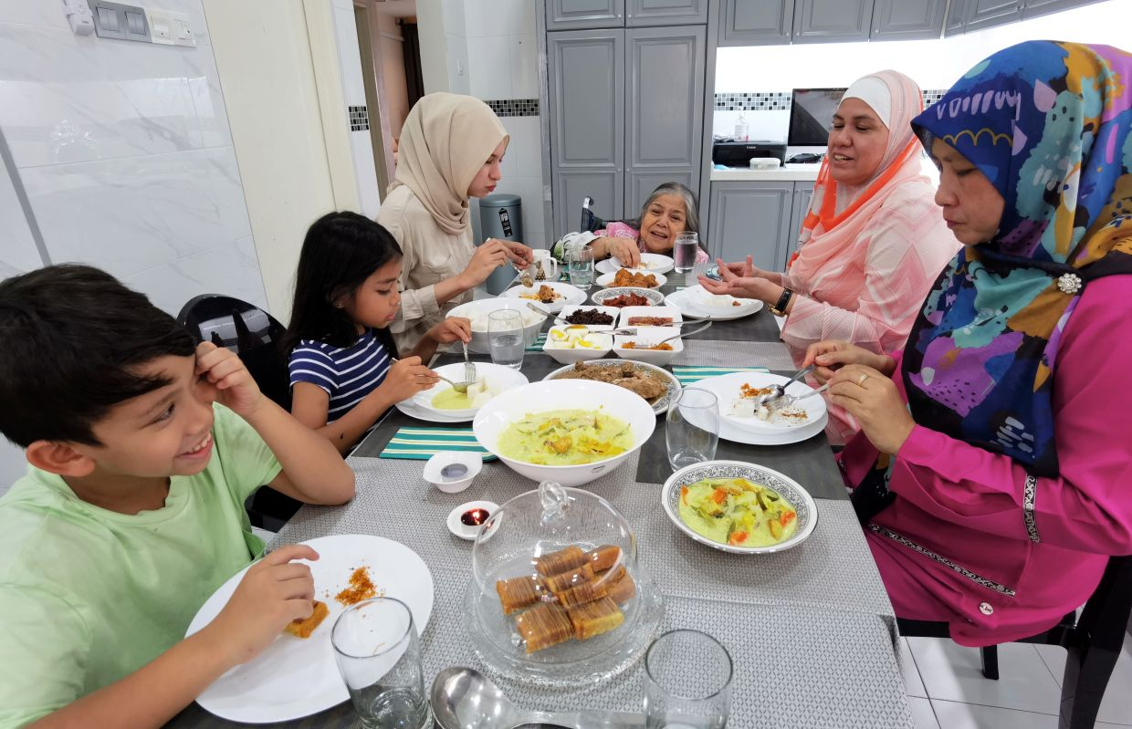 Balkis' family normally gets together to eat and celebrate Hari Raya. From left: nephew Mohd Ian Shafiq, niece Aleesya Suhaimi, niece Siti Rafanah Hussein, Esah, Balkis and family friend Zuridah Sam.