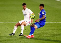 Soccer-Exhausted Real lose momentum in title race with draw at Getafe