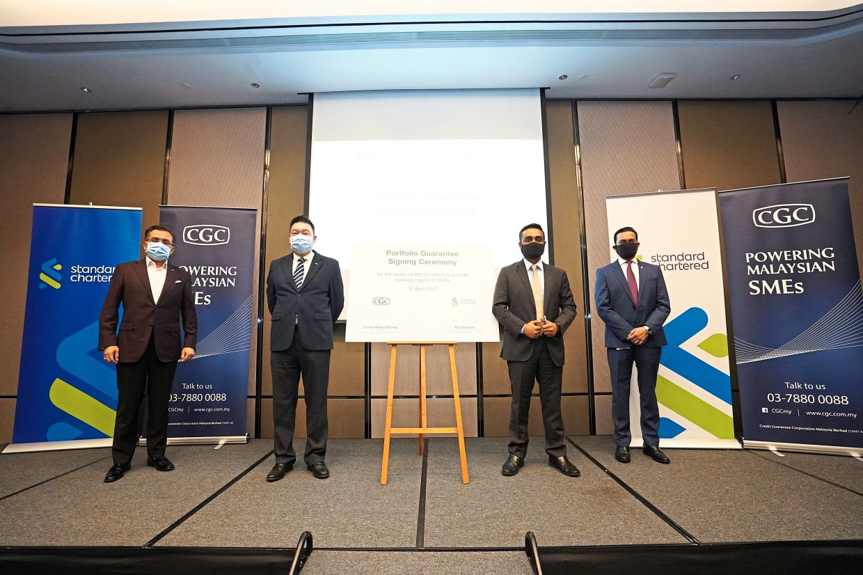 Financial help: (from left) Zamree, CGC chief business officer Leong Weng Choong, Standard Chartered Malaysia head of business banking Raj Tatavarty, and Abrar at the portfolio guarantee signing ceremony.