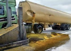 Tanker hits Juru toll plaza railing, spills 20,000l of cooking oil on highway
