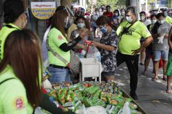 Free food pantries sprout in Philippines as aid are delayed