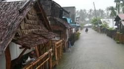 Two dead, 20 cargo ship crew missing amid typhoon in Philippines; tens of thousands remain in evacuation centres