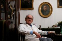 Through war and pandemics, Hungary's oldest GP still finds joy in healing at 97