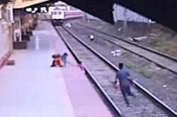 Indian railway worker who rescued child from oncoming train hailed as 'superhero'