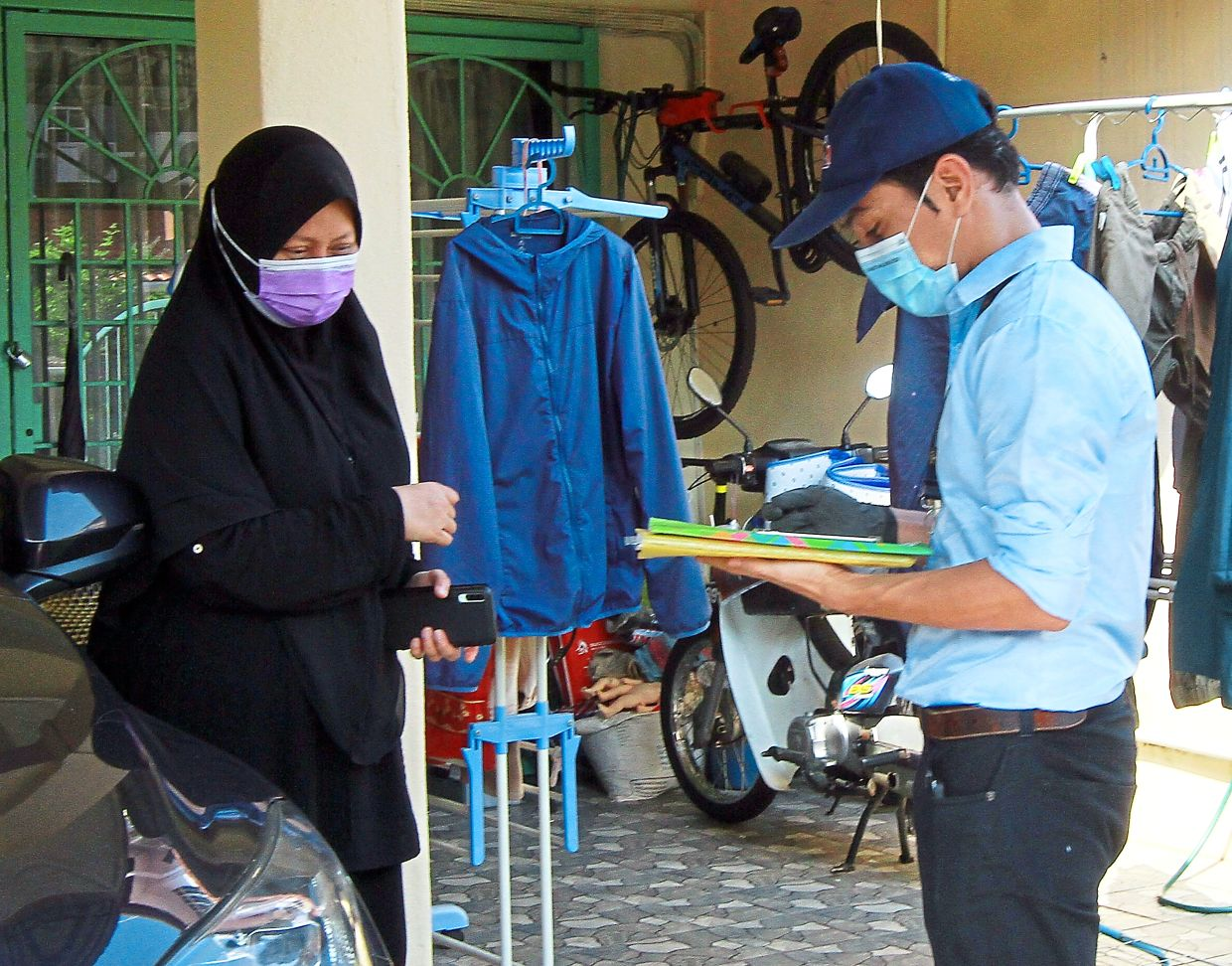 Puchong resident Noraidah Johar responding to the survey conducted face-to-face by an enumerator.