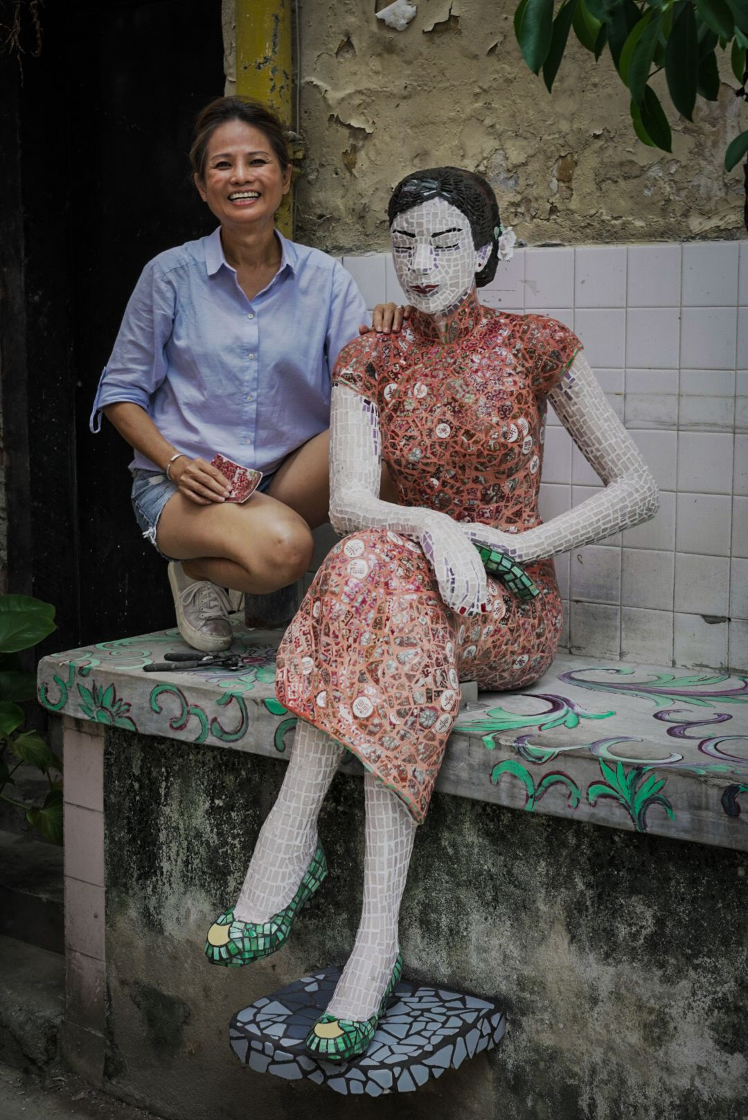 Alice Chang with her sculpture 'The Lady' at Kwai Chai Hong in KL. Photo: Javier Chor