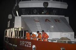 Search for missing Indonesian submarine enters second day as neighbours offer help