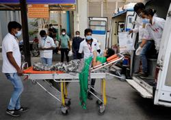 India posts daily rise of over 300,000 COVID-19 cases, record death toll