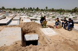 Gaza gravediggers and medics stretched as COVID spikes during Ramadan