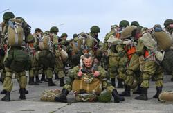 Russia orders soldiers to begin return to bases after drills near Ukraine