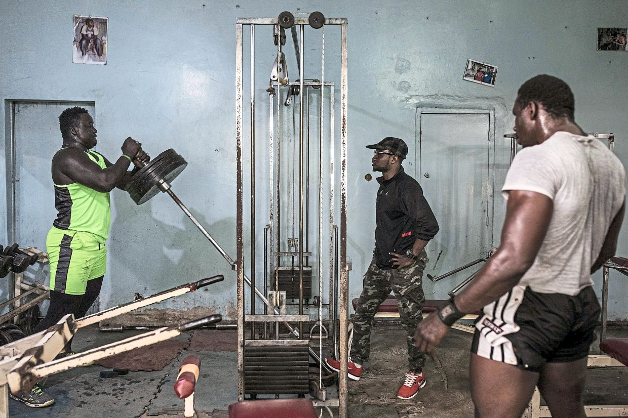 Professional Senegalese wrestler, Moussa Diop (left), working out in a gym that is specially opened for him, his training partner and coach in Dakar.