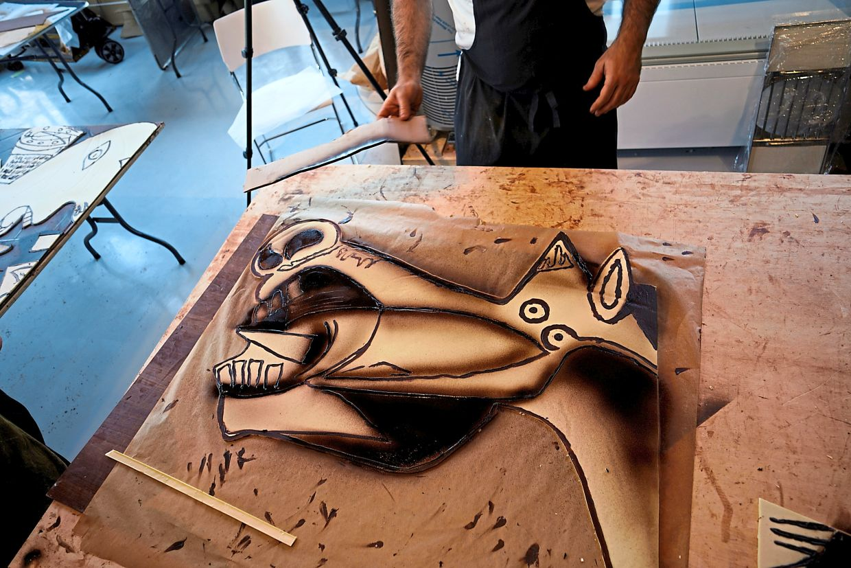 A close-up of one of the slabs of Picasso's 'Guernica' made with chocolate. Photo: Reuters