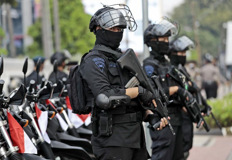 Police officers stand guard near the Association of Southeast Asian Nations (ASEAN) Secretariat ahead of a leaders' meeting in Jakarta, Indonesia, Friday, April 23, 2021. The 10-member Association of South-East Asian Nations is scheduled to hold a special summit to discuss Myanmar on Saturday. - AP