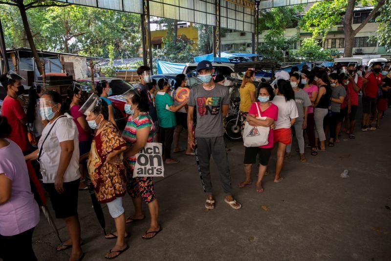 People queue for free food from a community pantry amid the coronavirus disease (Covid-19) outbreak, in Quezon City, Metro Manila, Philippines, April 23, 2021. - Reuters