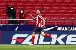 Atletico see off Huesca to stay in control of La Liga title race