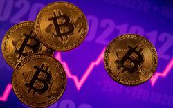 Bitcoin briefly drops below $50,000 amid tax-proposal anxiety