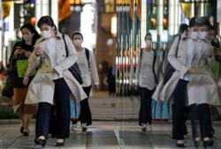 Japan declares 'short, powerful' emergency in Tokyo, elsewhere