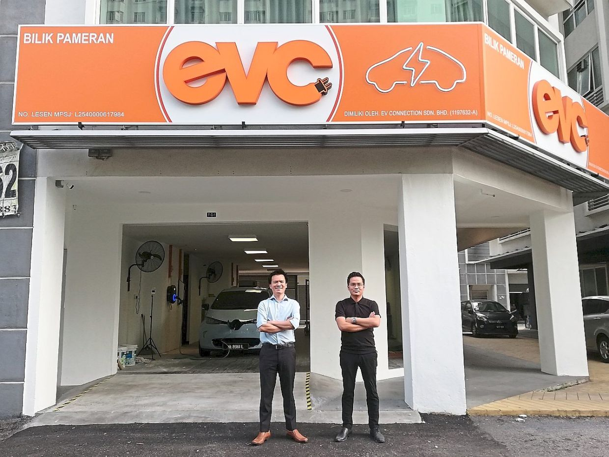Standing tall: EVC CEO Lee Yuen How (left) with EVC sales manager Kevin Lim at the new EV Charging Experience Centre in Kelana Jaya, Petaling Jaya.