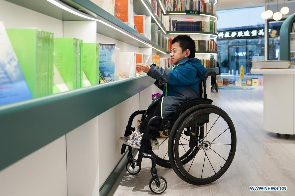 'Our bookstore is committed to spreading love and care to a wide range of people, and we hope everyone can have a delightful experience here, ' said Zhang Zhihao, manager of the bookstore. Photo: Xinhua/Asia News Network