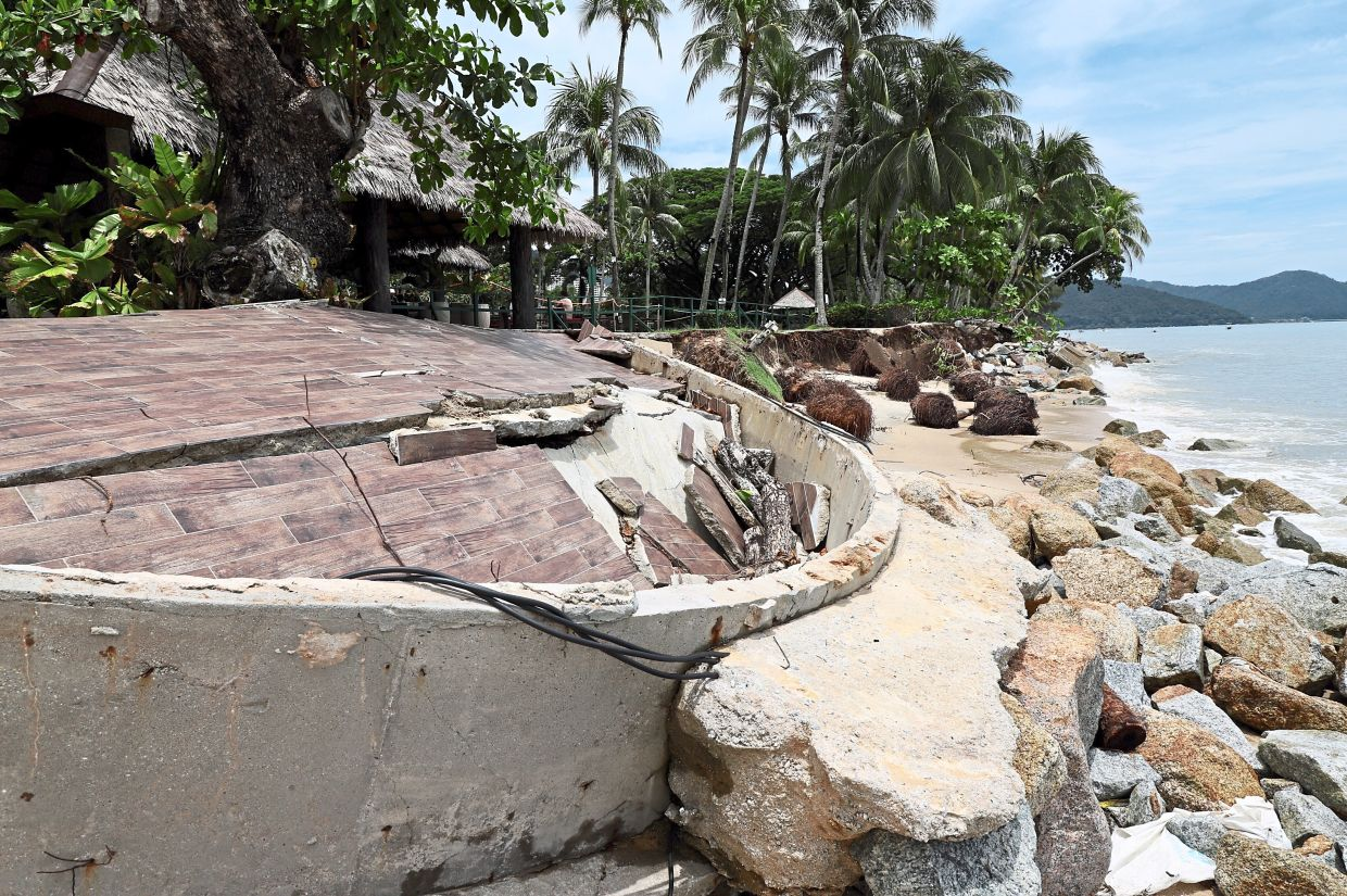 Exposed to the elements: Soil erosion caused by waves has destroyed a large tract of this once pristine beach in Batu Ferringhi, Penang. — LIM BENG TATT/The Star