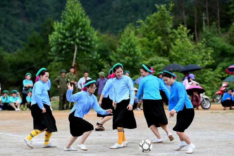 Ethnic San Chi women dressed in traditional costumes play a friendly football match as part of the Soong Co festival celebrations in northern Vietnam's Quang Ninh province on April 24, 2021. - AFP