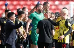 Soccer-Watford seal Premier League promotion with victory over Millwall